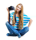 Woman photographer takes photos Royalty Free Stock Photos