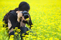 Woman photographer taking pictures in nature Royalty Free Stock Photo