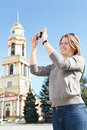 Woman photographing city's attractions Stock Photo