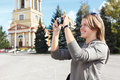 Woman photographing city's attractions Royalty Free Stock Photo
