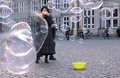 Woman photographing a crowd of soap bubbles in Bremen Germany