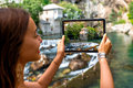 Woman photographing house on Buna spring in Blagaj Royalty Free Stock Photo