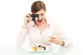 Woman photographing sushi young over white background Royalty Free Stock Images
