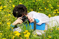 Woman photographs wild flowers Royalty Free Stock Image