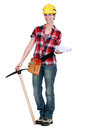Woman with a pickaxe and plans Stock Photo