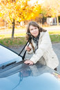 Woman picking up windscreen wiper beautiful and checking it Stock Images