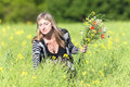 Woman picking wild flowers on the meadow in spring Royalty Free Stock Images