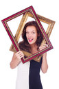 Woman with picture frame on white Stock Images