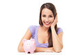 Woman with piggy bank casual young over white background Royalty Free Stock Images