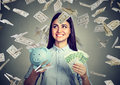 Woman with piggy bank and euro cash under dollar money rain Royalty Free Stock Photo