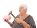 Woman with piggy bank senior breaking a Royalty Free Stock Photo