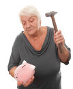 Woman with piggy bank senior breaking a Stock Images
