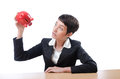 Woman and piggybank Stock Image