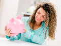Woman with a piggybank happy holding and smiling Stock Photography