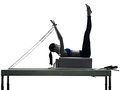 Woman pilates reformer exercises fitness Royalty Free Stock Photo