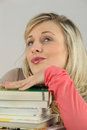Woman with pile of books blond a Stock Image
