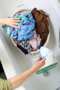 Woman Pile of dirty laundry washing Royalty Free Stock Image