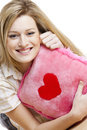 Woman with pillow with heart Stock Images