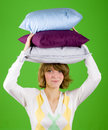 Woman with pillows stack Stock Photography