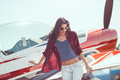 Woman pilot and airplane Royalty Free Stock Photo