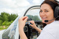 Woman pilot happy female in a private plane holding the keys and smiling to you Stock Photography