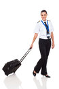 Woman pilot uniform beautiful young in airline walking with briefcase on white background Stock Photos