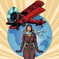 Woman pilot of a vintage biplane airplane Royalty Free Stock Photo