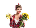 Woman with pin-up make-up, hairstyle holding gloves and yellow d Royalty Free Stock Photo