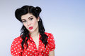 Woman pin up make up hairstyle posing in studio beautiful young with and Stock Photography