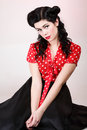 Woman pin up make up hairstyle posing in studio beautiful young with and Royalty Free Stock Image
