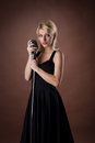 Woman pin-up portrait in black with microphone Royalty Free Stock Photography
