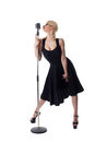 Woman pin-up portrait in black with microphone Royalty Free Stock Photo