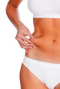 Woman pinches fat on the belly isolated white Royalty Free Stock Photography