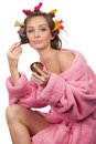 Woman in pink bath robe making-up Stock Photography