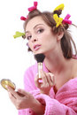 Woman in pink bath robe making-up Royalty Free Stock Images