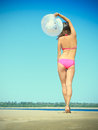 Woman in pink bikini with white hat on the beach Royalty Free Stock Photography