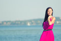 Woman in pink dress standing on the beach place for text Royalty Free Stock Image
