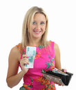 Woman in pink dress took banknote from her purse blonde caucasian years old with flowers smiles and holds one hand and open with Stock Image