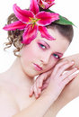 Woman with pink flower in hair Stock Photos