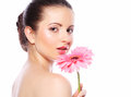 Woman with pink gerber flower isolated on white Royalty Free Stock Photo