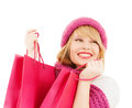Woman in pink hat and scarf with shopping bags winter people happiness concept many Stock Images
