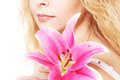 Woman with pink lily high key portrait beautiful blond Stock Photos