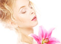 Woman with pink lily high key portrait beautiful blond Royalty Free Stock Image