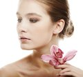 Woman with pink orchid beautiful Royalty Free Stock Photography