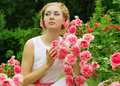 Woman in pink rose garden walking sensual Royalty Free Stock Photography
