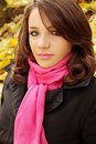 Woman in pink scarf portrait of a beautiful young autumn park Royalty Free Stock Images