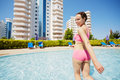 Woman in pink sportswear gets out of pool young smling half turning back Stock Images
