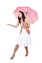 Woman with pink umbrella brunette in a white dress figuring what the weather is Royalty Free Stock Photography