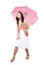 Woman with pink umbrella brunette in a white dress figuring what the weather is Royalty Free Stock Image