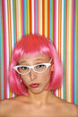 Woman in pink wig. Stock Images
